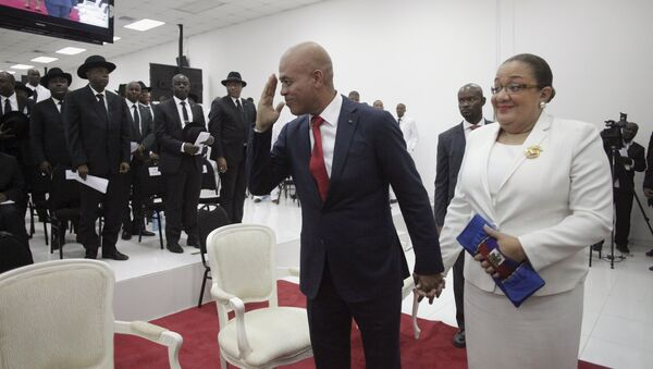 Haiti's former President Michel Martelly says goodbye as he accompanied by his wife Sophia at the end of a ceremony marking the end of his presidential term in the Haitian Parliament in Port-au-Prince, Haiti, February 7, 2016 - Sputnik International