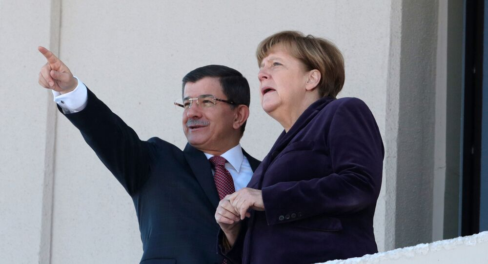 German Chancellor Angela Merkel, right, and Turkish Prime Minister Ahmet Davutoglu speak as they look towards the city center after a welcome ceremony in Ankara, Turkey, Monday, Feb. 8, 2016.