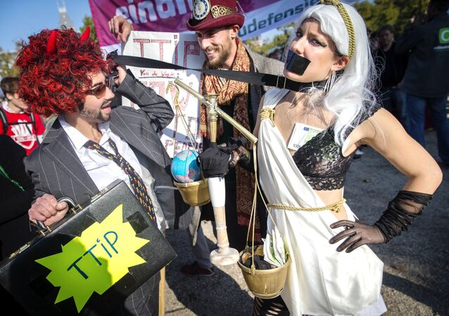 Dressed-up protesters take part in a rally against the Transatlantic Trade and Investment Partnership (TTIP), a massive free-trade accord being negotiated by the European Union and the United States, on October 10, 2015 in Amsterdam.