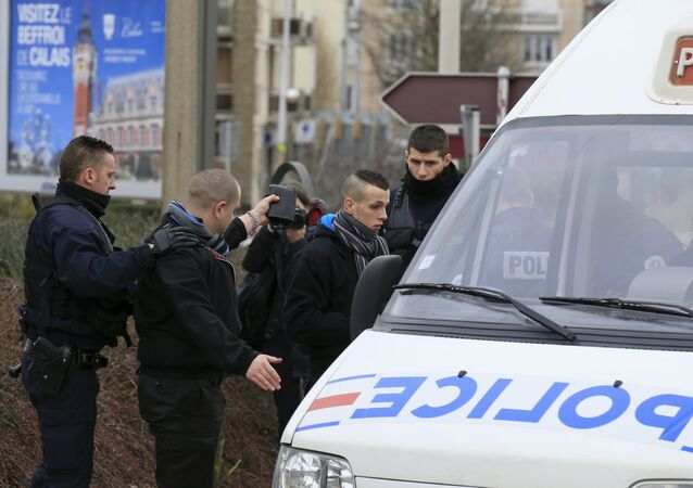 Police officers detain activists who were taking part in a demonstration against migrants, which was organized by the anti-Islam group PEGIDA, near the railway station of Calais, France, February 6, 2016.