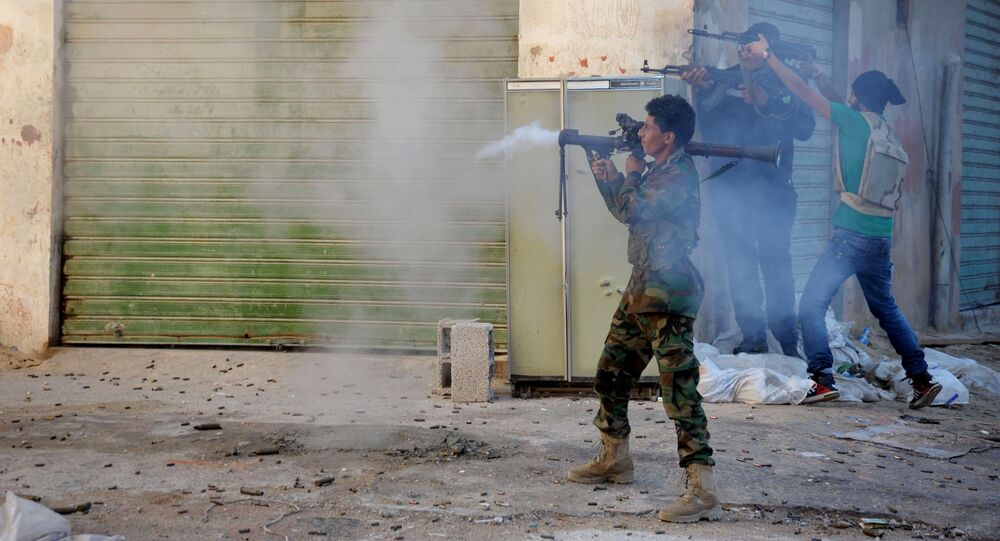 Libyan military soldiers fire their weapons during clashes with Islamic militias in Benghazi. Libya. (File)