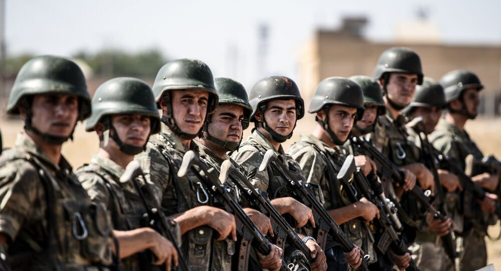 Turkish soldiers stand guar near the Turkey-Syrian border post in Sanliurfa (file photo)