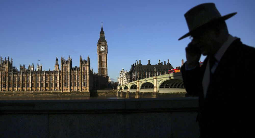 A man is silhouetted in front of the Houses of Parliament on a sunny winter's morning in London, Britain January 15, 2016.