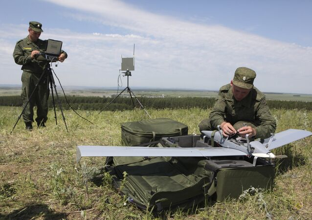 Servicemen prepare a Zastava unmanned aerial vehicle for launch in the assembly area of combined forces of the Central Military District and airborne troops at the Chebarkul firing range as part of a sudden operational readiness test