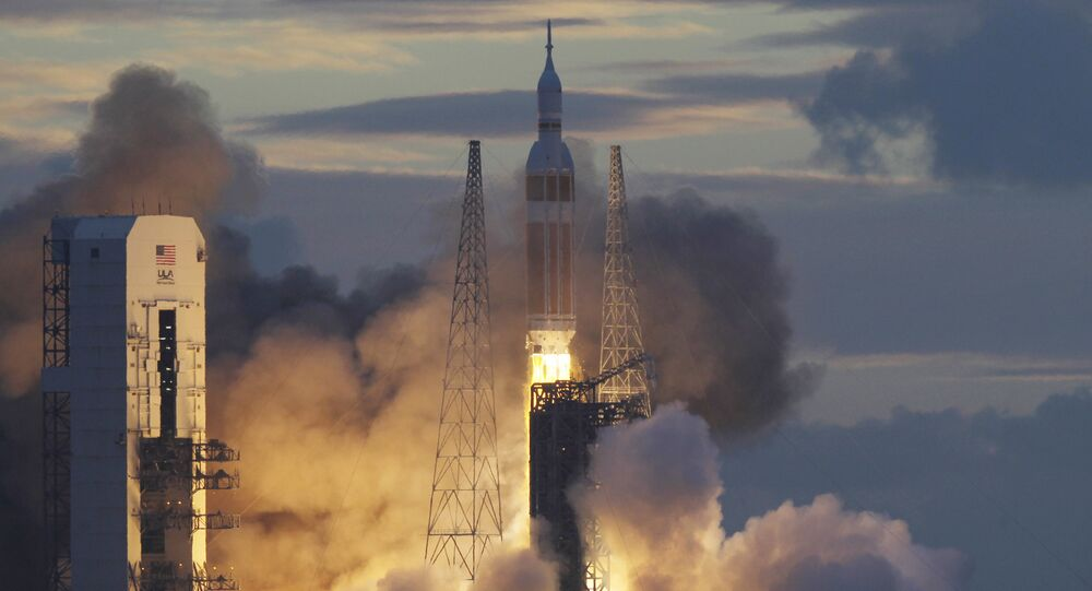 NASA Orion capsule on top of a Delta IV rocket lifts off on its first unmanned orbital test flight from Complex 37 B at the Cape Canaveral Air Force Station, Friday, Dec. 5, 2014 at Cape Canaveral, Fla