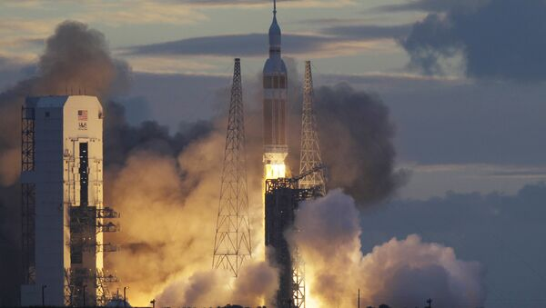 NASA Orion capsule on top of a Delta IV rocket lifts off on its first unmanned orbital test flight from Complex 37 B at the Cape Canaveral Air Force Station, Friday, Dec. 5, 2014 at Cape Canaveral, Fla - Sputnik International