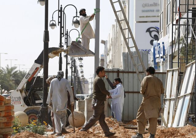 Labourer work to remove a pole outside a residential building in Riyadh, Saudi Arabia February 9, 2016