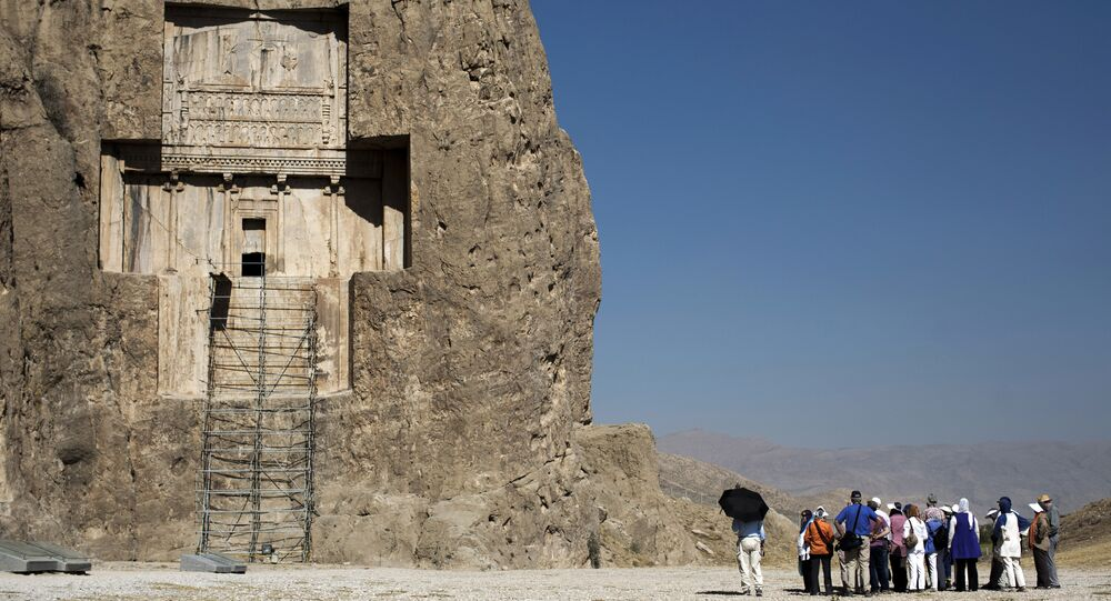 Tourists visit the tomb of Achaemenid empeor, Darius I the Great at Naqsh-e Rostam necropolis, located about 12 km northwest of Persepolis, near Shiraz in southern Iran on September 26, 2014