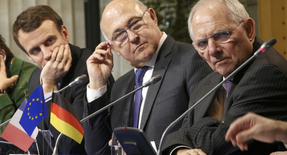 French Economy Minister Emmanuel Macron (L), French Finance Minister Michel Sapin (C) and German Finance Minister Wolfgang Schaeuble (R) attend a news conference as part of a Franco-German Economic and Financial Council at the Bercy Finance Ministry in Paris, France, February 9, 2016.