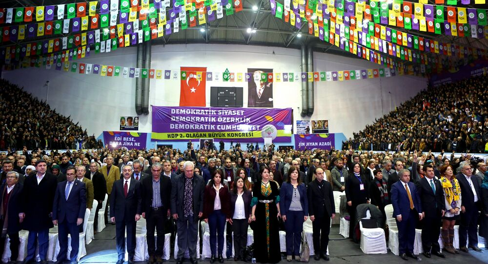 Party members stand during the second general assembly of the Peoples' Democratic Party (HDP) at Ahmet Taner Kislali Sports Hall in Ankara on January 24, 2016