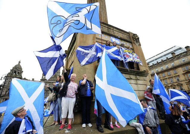 Pro-independence supporters waves the Scottish flag during a rally in George Square in Glasgow, Scotland, on September 19, 2015