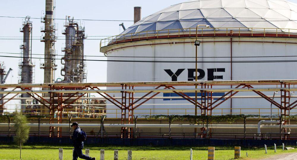 A man runs in front of a YPF oil company refinery plant in La Plata, Argentina (File)