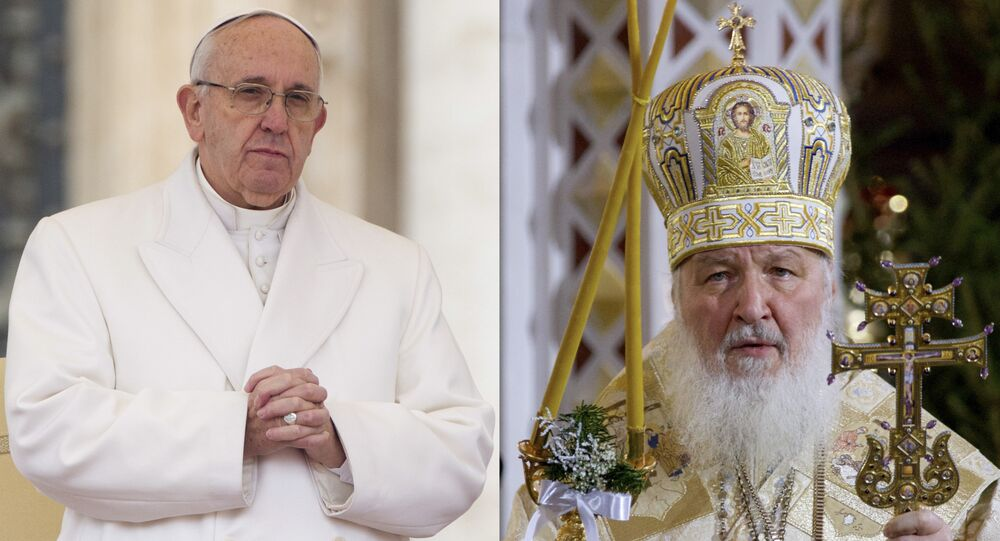 FILE - In this file photo combination Russian Orthodox Patriarch Kirill, right, serves the Christmas Mass in the Christ the Savior Cathedral in Moscow, Russia, on Thursday, Jan. 7, 2016 and Pope Francis prays during an audience at the Vatican on Saturday, Jan. 30, 2016