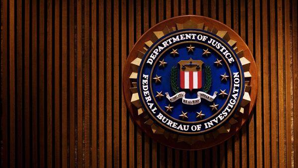 A crest of the Federal Bureau of Investigation is seen 03 August 2007 inside the J. Edgar Hoover FBI Building in Washington, DC. - Sputnik International