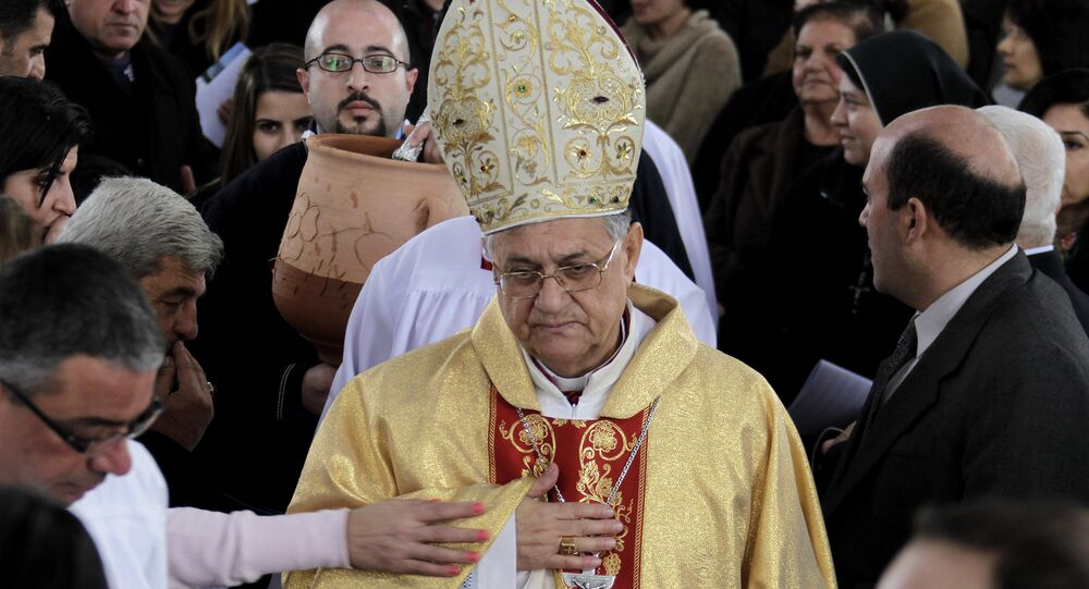 Latin Patriarch of Jerusalem Fuad Twal leads an annual pilgrimage to the Baptism Site in Bethany, Jordan, on January 10, 2014