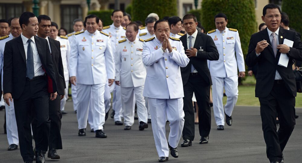Thailand's deputy prime minister and defence minister General Prawit Wongsuwan (C) makes a traditional greeting as he arrives for a cabinet group picture following a reshuffle on August 20 to include 10 new ministers, at Government House in Bangkok on August 25, 2015