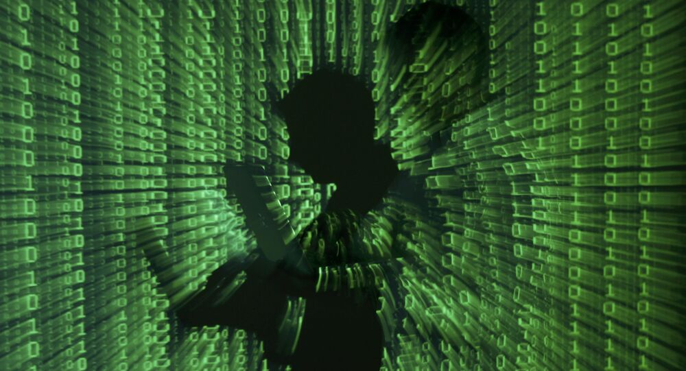 An illustration picture shows a projection of binary code on a man holding a laptop computer.