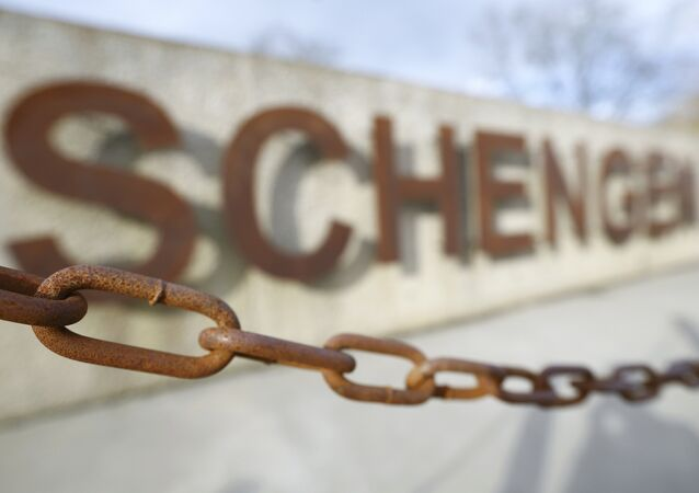 A rusty chain hangs in front of the quay of the small Luxembourg village of Schengen at the banks of the river Moselle January 27, 2016.