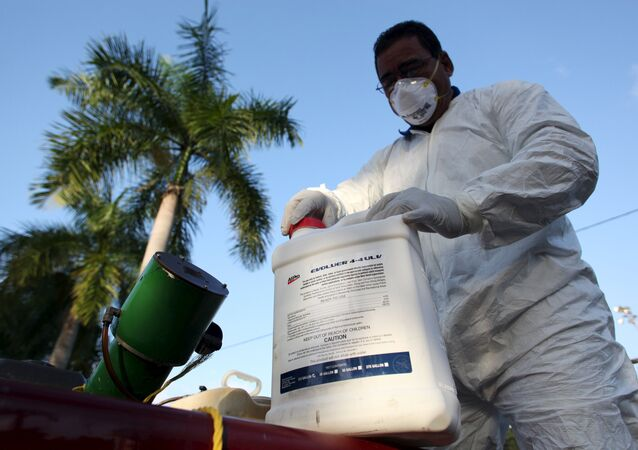 A health worker prepares insecticide before fumigating in a neighborhood in San Juan, January 27, 2016