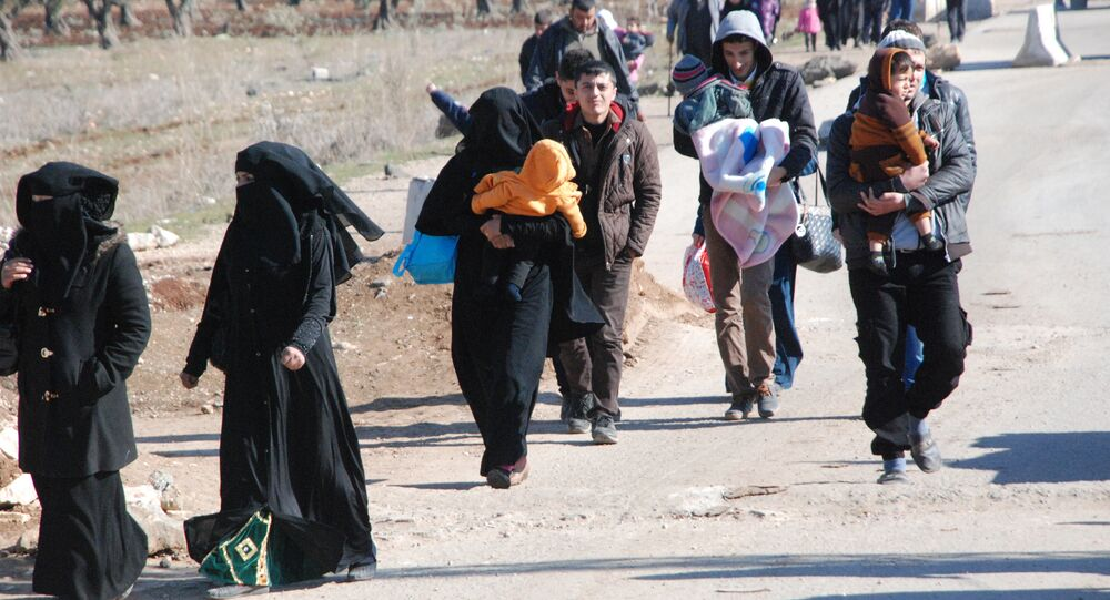 Refugees arriving in Afrin