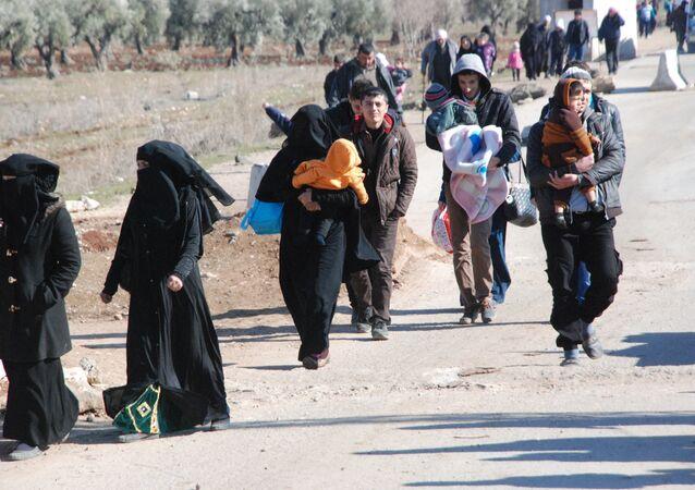 Refugees arriving in Afrin