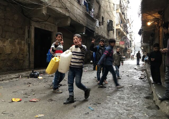 Children in Nubel, north of Aleppo province in Syria, after the town was released from a long-term siege