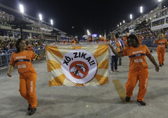 Workers holds a flag that reads in portugues Out Zika as part of a campaign to warn people about the spread of the Zika virus during carnival celebrations at the Sambadrome in Rio de Janeiro, Brazil, Monday, Feb. 8, 2016