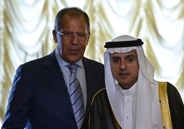 Russian Foreign Minister Sergei Lavrov (L) and his Saudi counterpart Adel Al-Jubeir