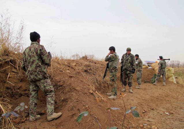 Afghan National Army (ANA) soldiers stand guard during an operation against Taliban militants in the Nad Ali district of Helmand on December 26, 2015