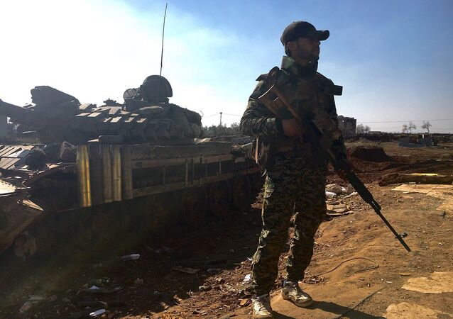 A soldier of the Syrian Army, which began an assault on the town of Osman in Syria's province of Daraa