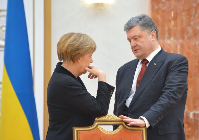 German Chancellor Angela Merkel and Ukrainian President Petro Poroshenko before an expanded meeting to discuss a peace plan for Ukraine, held by the Russian, German, French and Ukrainian leaders