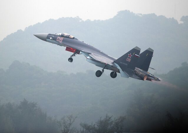 A Sukhoi SU-35 fighter jet takes off during a test flight ahead of the Airshow China 2014 in Zhuhai, South China's Guangdong province on November 10, 2014