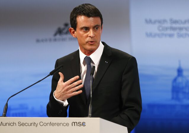 French Prime Minister Manuel Valls gestures during his speech on the podium at the Security Conference in Munich, Germany, Saturday, Feb. 13, 2016