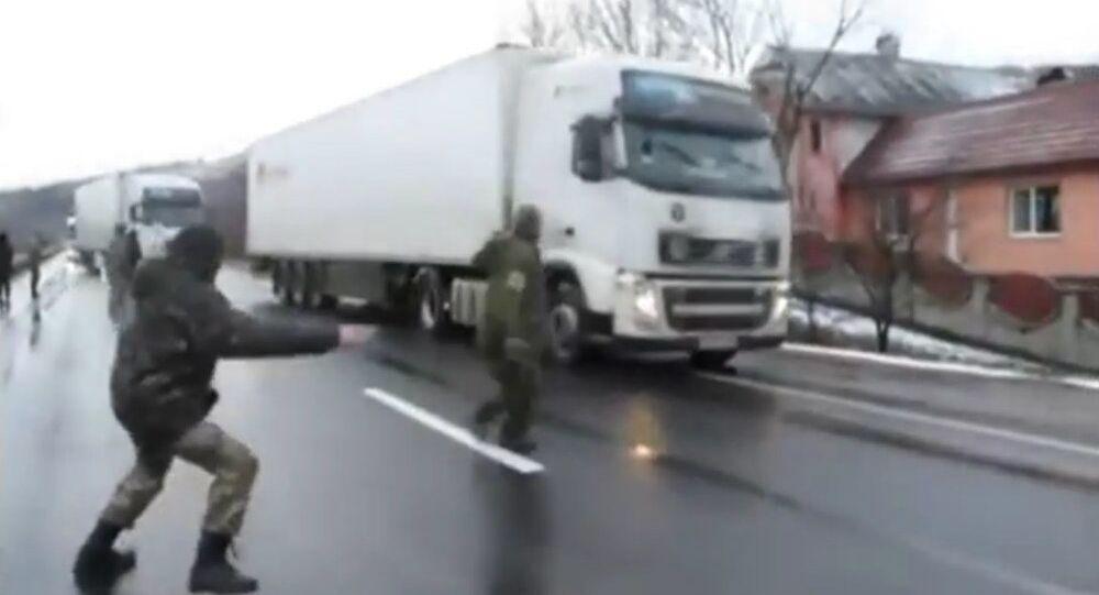 Nationalist activists in Ukraine blockade Russian trucks