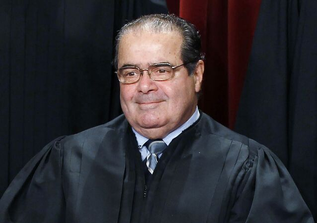 U.S. Supreme Court Justice Antonin Scalia is seen during a group portrait in the East Conference Room at the Supreme Court Building in Washington, in this file photo taken October 8, 2010.