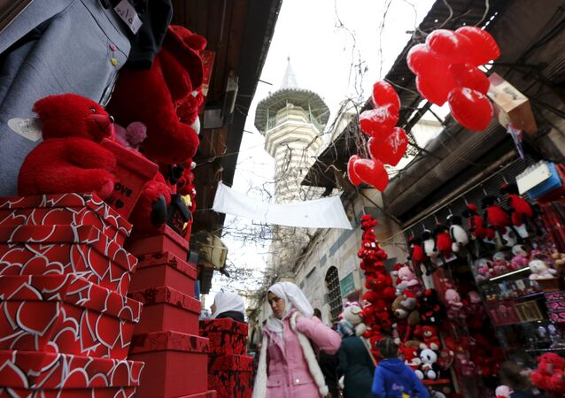 People shop for Valentine's Day gifts in al-Qaimaryeh street, in old Damascus, Syria February 11, 2016