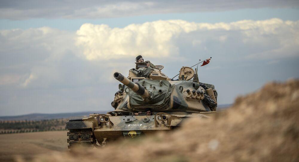 Turkish army tanks take position near the Syrian border