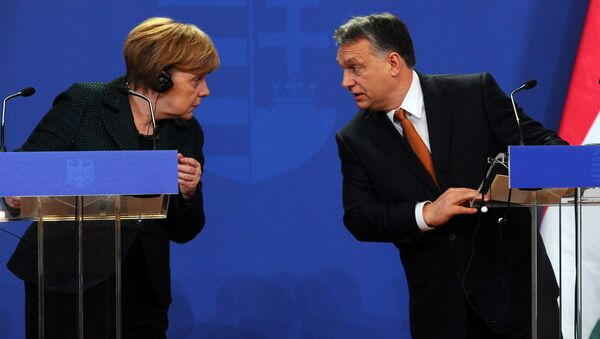 German Chancellor Angela Merkel (L) chats with her host Hungarian Prime Minister Viktor Orban (R) in the parliament building of Budapest on February 2, 2015 during their joint press conference during her first visit to Hungary in last five years. - Sputnik International