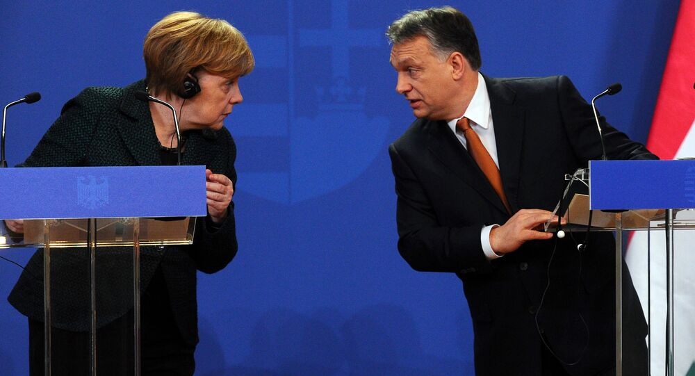 German Chancellor Angela Merkel (L) chats with her host Hungarian Prime Minister Viktor Orban (R) in the parliament building of Budapest on February 2, 2015 during their joint press conference during her first visit to Hungary in last five years.