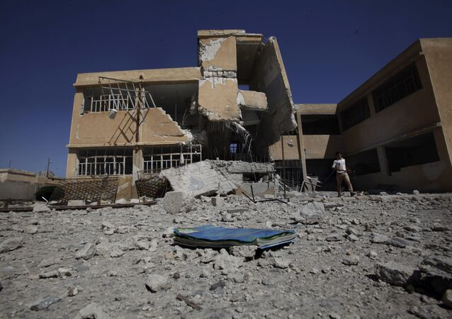 A book is left on the ground at the yard of a school in Tel Rifaat, on the outskirts of Aleppo, Syria. File photo