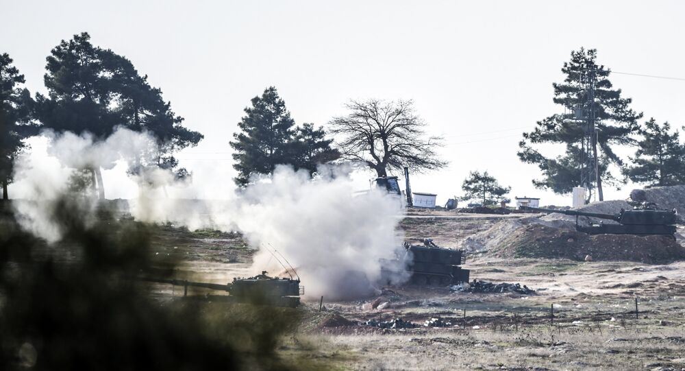 Tanks of the Turkish army shoot in the direction of Syria, near the Syrian border
