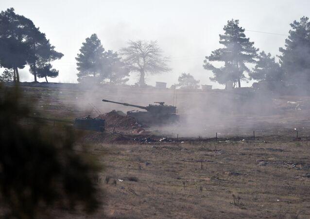 Turkish artillery fire from the border near Kilis toward northern Syria, in Kilis, Turkey, Monday, Feb. 15, 2016.