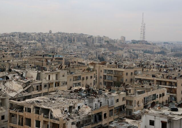 A picture taken on November 24, 2014, shows damaged buildings in the rebel-held Ansari disctrict of the northern Syrian city of Aleppo.