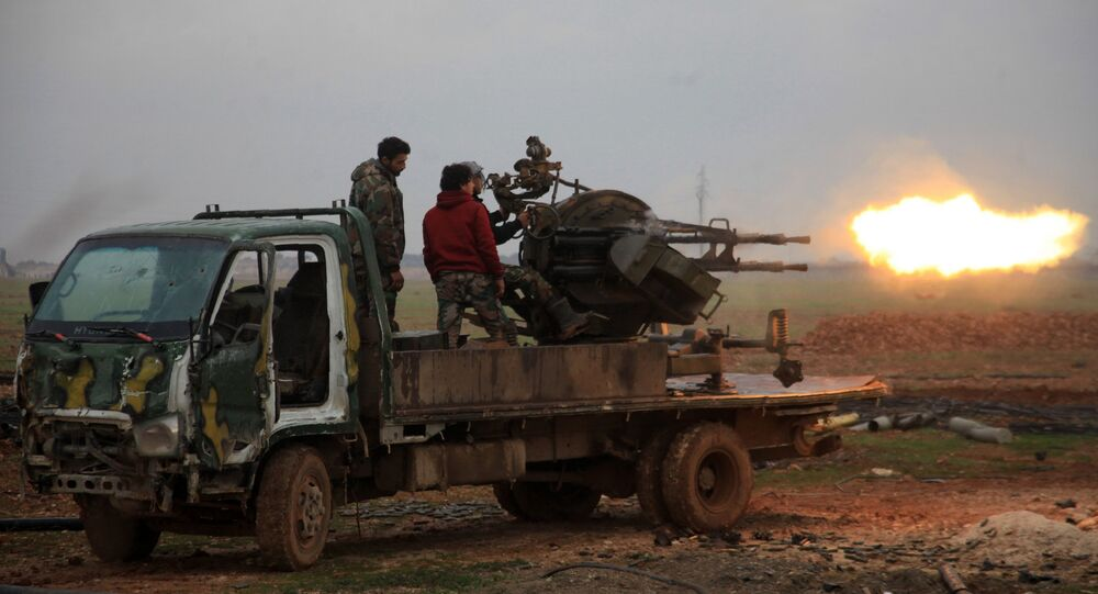 Forces loyal to Syrian President Bashar Assad fire towards Daesh terrorists south of the town of Al-Bab, in the northern province of Aleppo. file photo