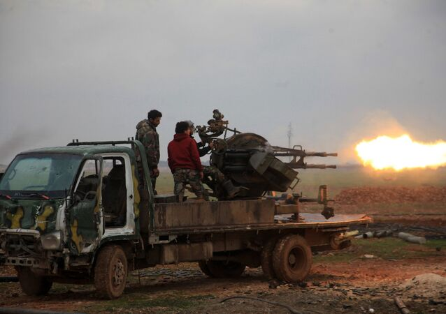 Syrian regime forces fire towards Daesh jihadists south of the town of Al-Bab, in the northern province of Aleppo on January 14, 2016.
