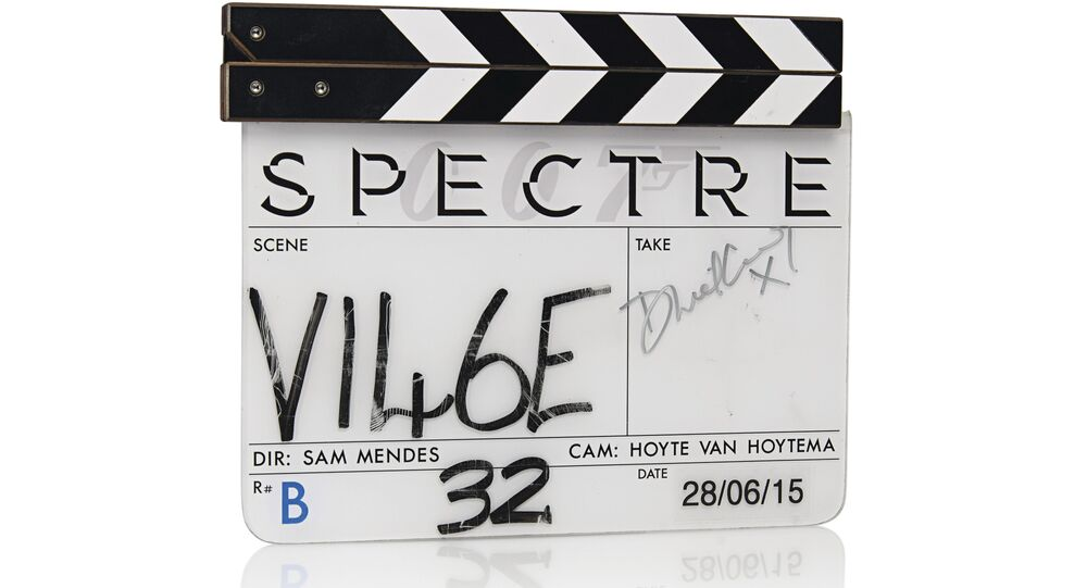 Spectre clapper board used during filming signed by Daniel Craig in silver marker.