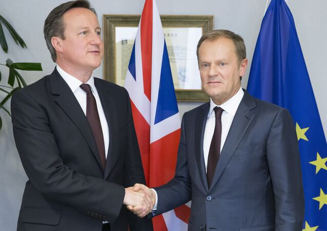British Prime Minister David Cameron (L) and EU Council President Donald Tusk shake hands prior to their meeting ahead of an EU summit, at the EU Council in Brussels on June 25, 2015.