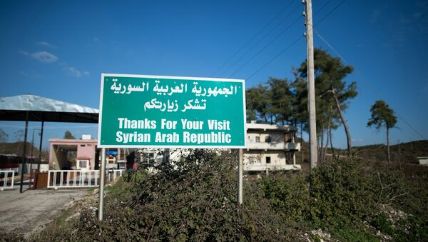 A sign by a closed checkpoint at the Syrian-Turkish border near the town of Kessab - Sputnik International