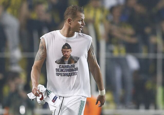 16/02/16 Lokomotiv Moscow's Dmitri Tarasov wearing a t-shirt depicting Russian President Vladimir Putin leaves the pitch after the match. The sign reads, Most polite president.