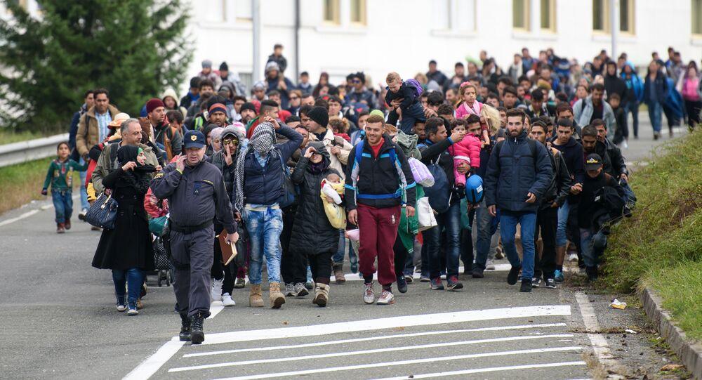 Migrants and refugees across the Slovenian-Austrian border in Sentilj towards Spielfeld on October 18, 2015.